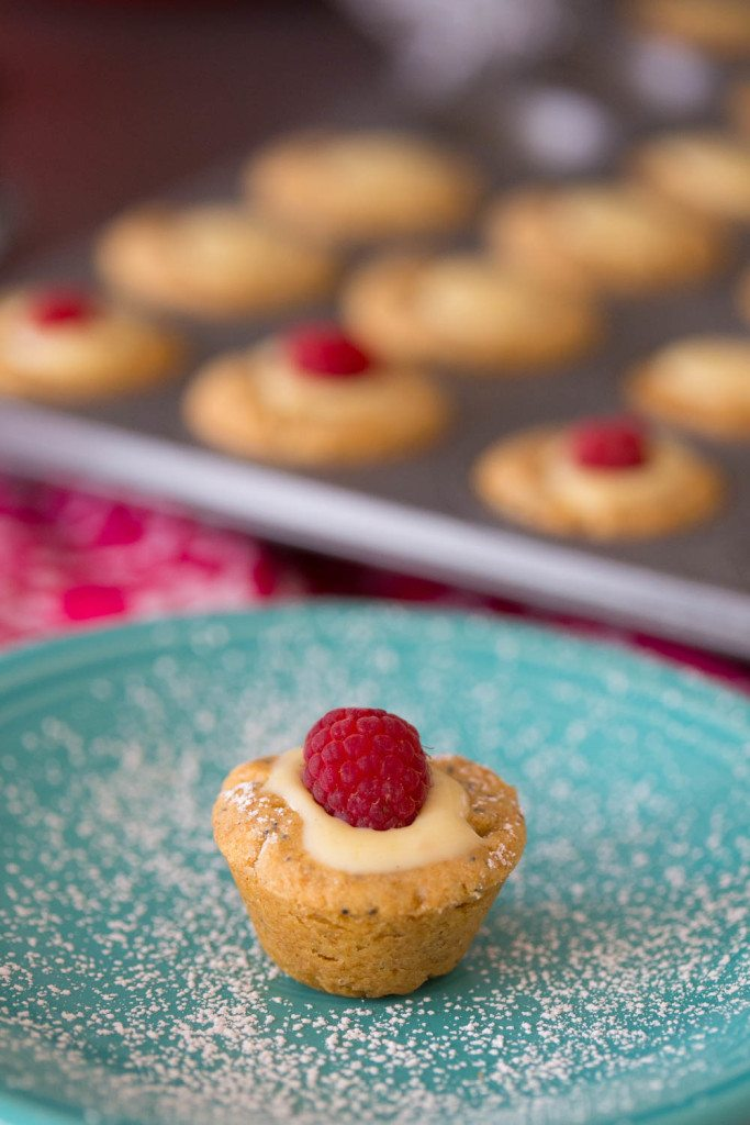 Lemon Blossom Thumbprint Cookie Cups are a perfectly springy sweet treat! Easy to make and full of lemony flavor, these little darlings would be delightful for your next wedding or baby shower, garden party, or Mother's Day brunch!