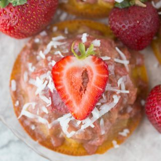 Mini Gluten Free Strawberry Rhubarb Upside Down Cake Recipe: ursting with sweet strawberries, sour rhubarb, and a spritz of summery lemon, these gluten-free & refined sugar-free w/ vegan option Strawberry Rhubarb Upside Down Cakes taste like a breezy summer day in the Southern sun!