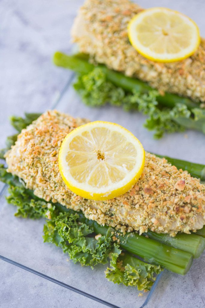 Paleo Coconut Cashew Crusted Mahi Mahi is a quick, easy, and healthy dinner option that's ready in under 20 minutes! Serve it up with a side of fresh grilled asparagus and caramelized pineapple, and you'll feel like you were whisked away to the tropics.  | www.slimpickinskitchen.com