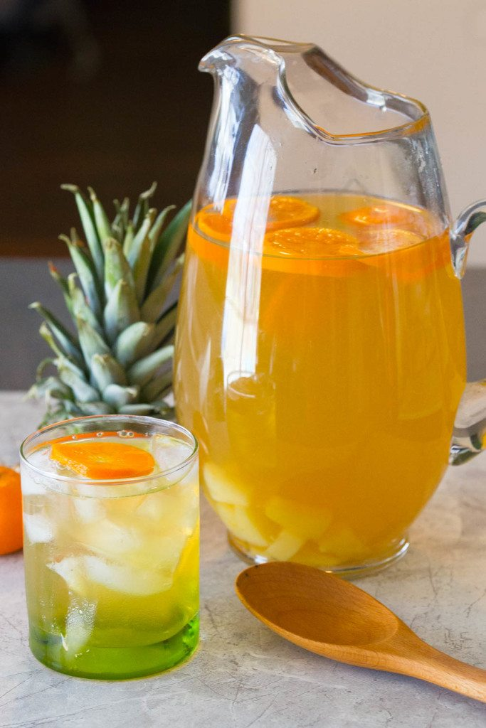 Home brewed Pineapple Orange Green Tea is crisp and cool with a hint of citrus and pineapple to get you ready for spring! Serve as is for a family friendly St. Patrick's Day, Mother's Day, or Easter drink or sassify it w/ a shot of rum or Irish whiskey.