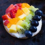 Personal Rainbow Fruit Pizzas with Key Lime Cream Cheese Frosting
