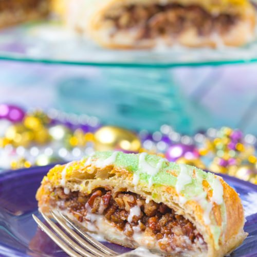 Sliced Pecan Praline Puff Pastry on a purple plate with silver fork