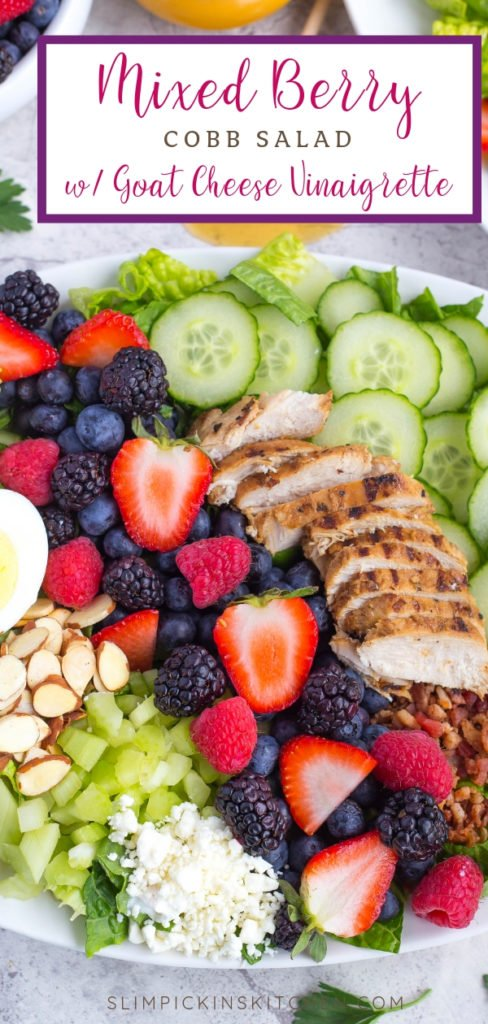 Close up of Mixed Berry Cobb Salad with berries, grilled chicken, sliced cucumbers, and almonds