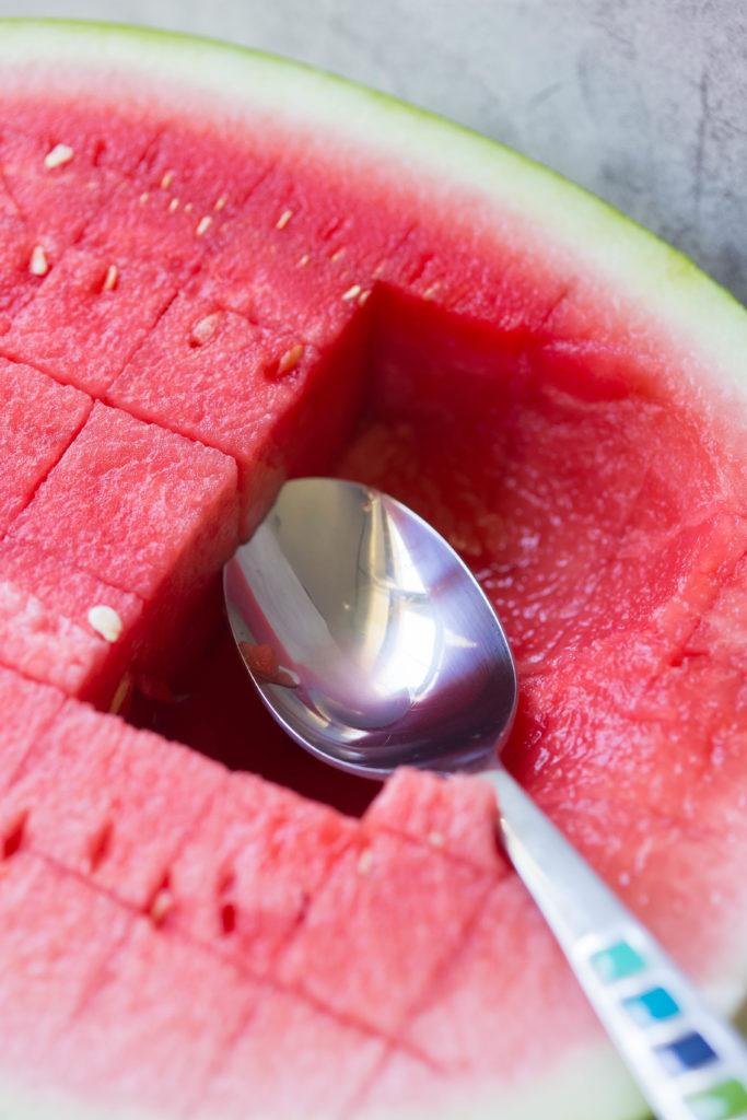 Silver spoon in watermelon