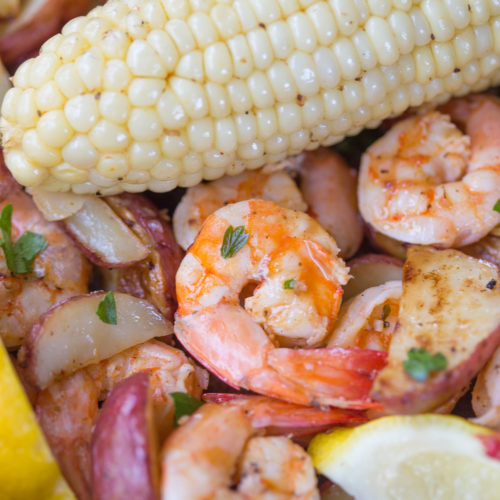 Very close up picture of broiled shrimp and corn