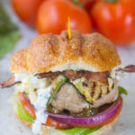 Close up of turkey burger w/ dripping goat cheese spread