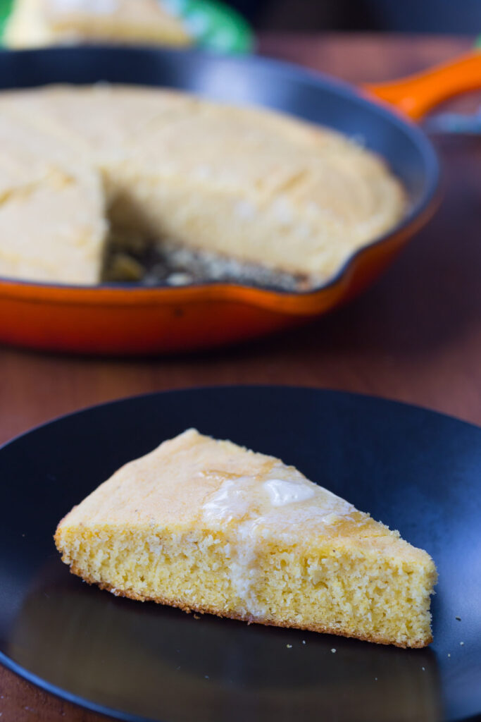 Slice of buttermilk cornbread with melted butter on top