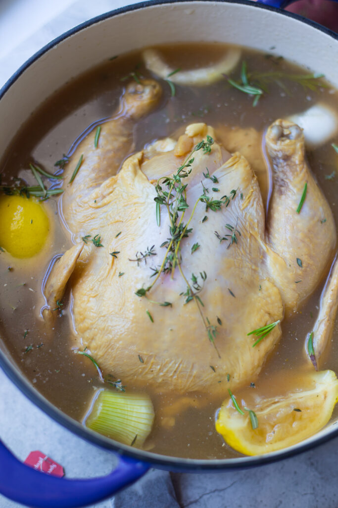 Raw Chicken surrounded by lemons in sweet tea brine