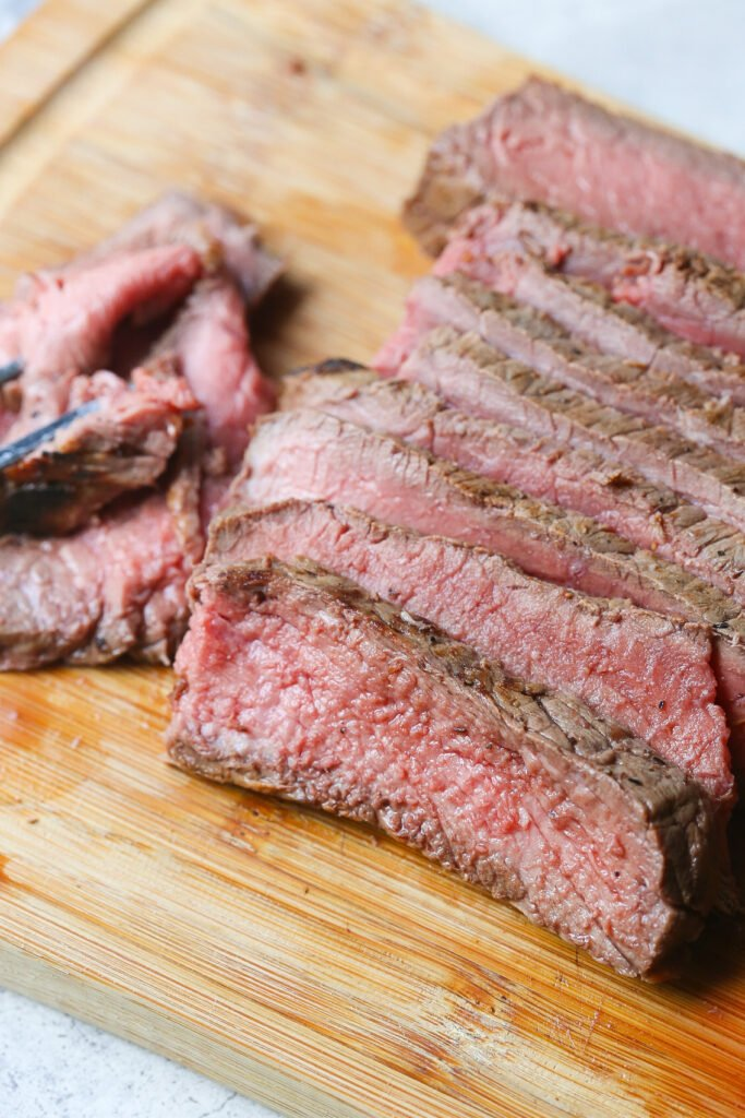 Slices of London Broil on cutting board